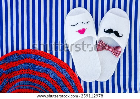 Dreaming about summer vacation on sunny beach lying on a stripe towel - stock photo