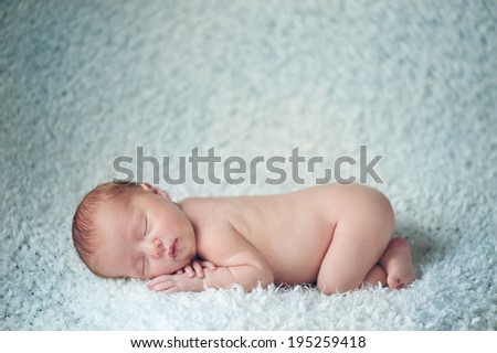 Dreaming and Sleeping Naked Newborn Baby - stock photo