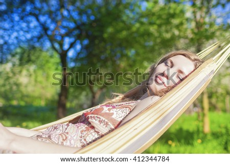 Dreaming Caucasian Blond Woman Resting in Hummock Outdoors.Horizontal  Shot - stock photo