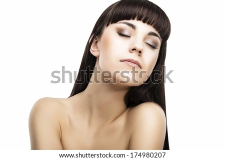 Dreaming Caucasian Woman with Long Straight Black Hair. Beauty Portrait. Isolated Over White. Horizontal Image