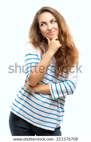 Dreaming girl.Blue background - stock photo