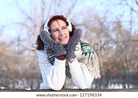 Dreaming girl in a winter park - stock photo