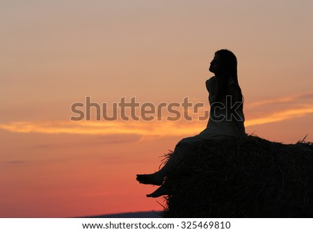 Dreaming girl on hay stack