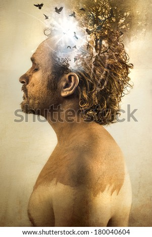 Dreaming, man covered in mud, naked, in profile, dirty skin - stock photo