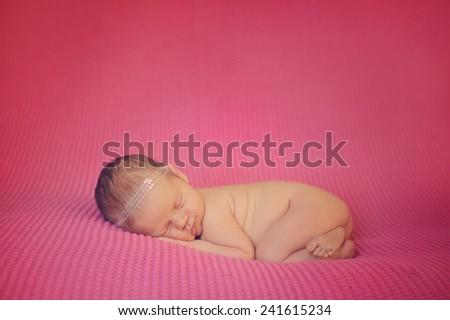 Dreaming Naked Newborn - stock photo