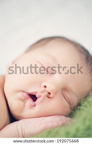 Dreaming Naked Newborn Baby - close vertical portrait