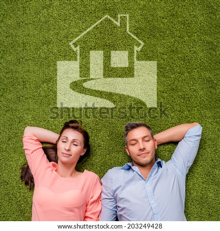 dreaming new real estate couple - stock photo