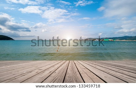 Dreaming on a empty wooden pier. - stock photo