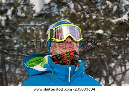 Dreaming snowboarder in winter forest - stock photo