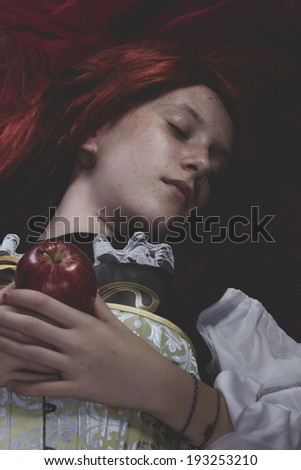Dreaming, Teen with a red apple lying, tale scene - stock photo
