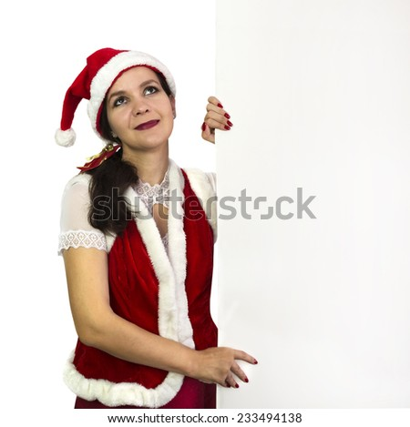 Dreaming young woman in Santa helper costume holding white blank billboard, Christmas and New Year image, isolated on white, with copy space - stock photo