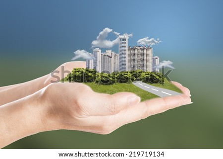 Dreams city hold with your hand for keep and clear environment - stock photo