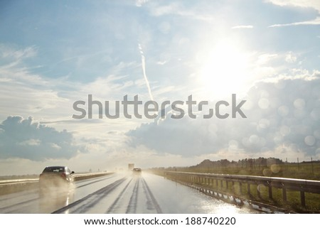 Dreams, hopes...Romantic sunny-rainy road. Canon 5D. - stock photo
