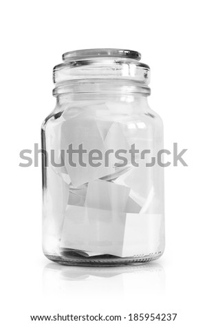 Dreams written on paper in glass jar, isolated on white