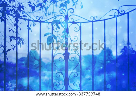 Dreamy background with beautiful, old, stylich, garden gate with bokeh lights - stock photo