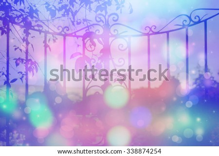 Dreamy background with beautiful, old, stylish, garden gate with bokeh lights - stock photo
