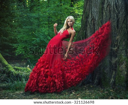 Dreamy blonde beauty posing in a mystic forest - stock photo