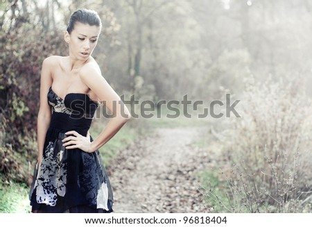 Dreamy fashion concept in forest - stock photo