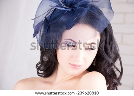 Dreamy girl in blue hat with ribbons - stock photo