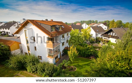 Dreamy house in European suburb - stock photo