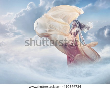 Dreamy image of a beautiful young lady in the clouds - stock photo