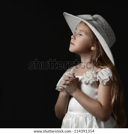 Dreamy romantic child girl in white dress and hat. Pretty sensitive girl 10 years old. - stock photo