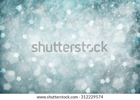 Dreamy silver blue colored abstract snowfall Christmas and New Year illustration background with sparkle. Beautiful silver cyan colored Christmas and New Year Holiday greeting card. - stock photo