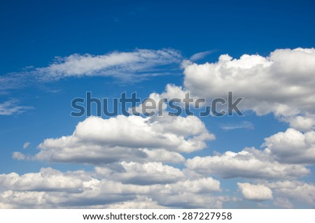 Dreamy sky with puffy clouds in sunny day with holiday relax feeling background - stock photo