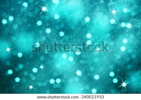 Dreamy turquoise color blurry bokeh with snowflakes and sparkle illustration. Lovely Christmas and New Year Holiday greeting card copy space background. - stock photo