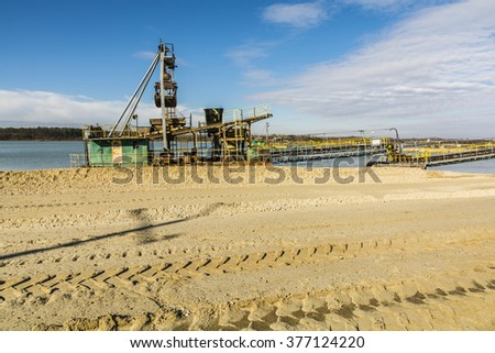 Dredger in anticipation of the work on the gravel pit.  - stock photo