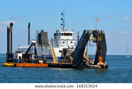 Dredger on the inlet of St. Augustine, Florida. - stock photo