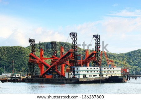 dredger ship at the  harbour Europoort - stock photo