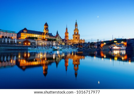 Dresden at evening reflected in water of Elbe. Blue hour after sunset