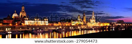 Dresden, Germany, 24. August 2014 - Dresden Cathedral of the Holy Trinity and the Royal Palace seen from the Elbe river at sunset.