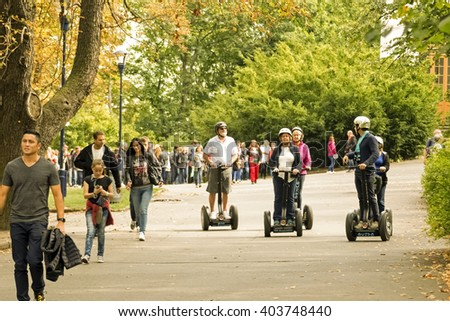 Dresden, Germany, 02 AUGUST, 2015: Group of older people ride the segway in the summer park - stock photo