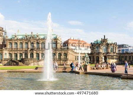 DRESDEN, GERMANY - AUGUST 22: Tourists at the Zwinger palace in Dresden, Germany on August 22, 2016. By 1963 the Zwinger had largely been restored after it was completely destroyed 1945.