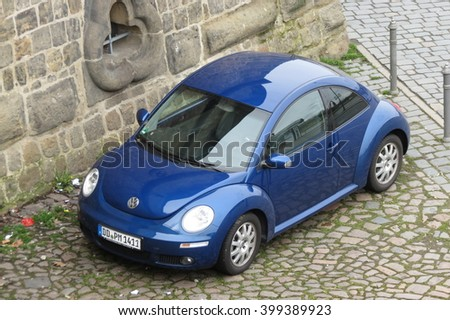 DRESDEN, GERMANY - CIRCA MARCH 2016: blue Volkswagen New Beetle car parked in a street of the city centre