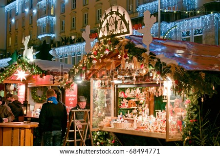 DRESDEN, GERMANY - DEC 20: People enjoy Christmas market in Dresden on December 20, 2010 in Dresden. It is Germany's oldest Christmas Market with a very long history dating back to 1434. - stock photo
