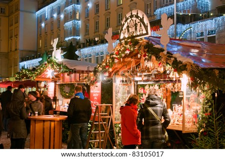 DRESDEN, GERMANY - DECEMBER 20: People enjoy Christmas market in Dresden on December 20, 2010 in Dresden, Germany. It is Germany's oldest Christmas Market with a very long history dating back to 1434. - stock photo