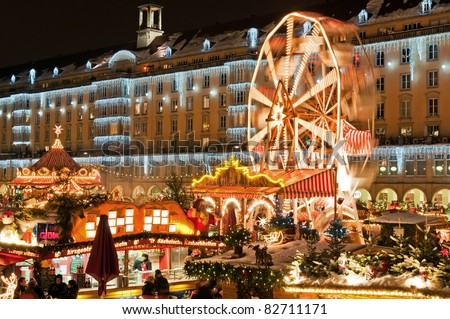 DRESDEN, GERMANY - 20 DECEMBER: People enjoy Christmas market on December 20, 2010 in Dresden, Germany. It is Germany's oldest Christmas Market with a very long history dating back to 1434. - stock photo