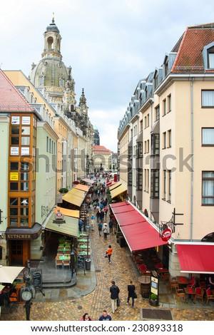 DRESDEN, GERMANY - JUNE, 26th, 2014: Munzgasse street during rain on 26th June 2014. - stock photo