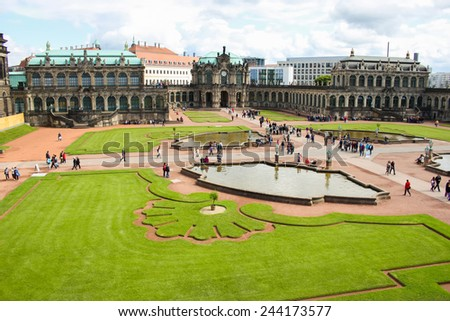 DRESDEN, GERMANY - JUNE, 20th, 2014: Side-top view of Zwinger palace main garden with fountains and grass. Zwinger palace is famous landmark of Dresden, Germany, during sunny day on 20th June 2014.