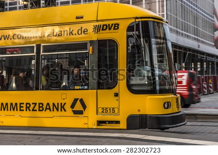 DRESDEN, GERMANY - MARCH 6, 2014: Modern tram in Dresden in a beautiful day.