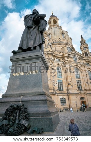 DRESDEN, GERMANY – OKTOBER 12, 2017: Monument of the reformer Martin Luther in front of the Frauenkirche on the Neumarkt in Dresden