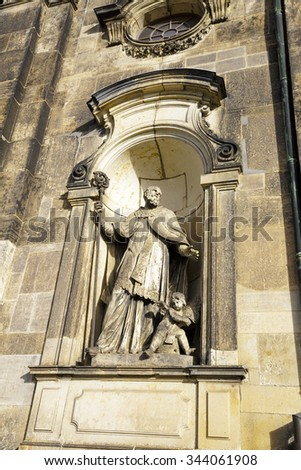 DRESDEN, GERMANY - SEPTEMBER 19, 2015: Sculpture adorned the facade of the Cathedral of the Holy Trinity, former church of Royal Court of Saxony, , the church was commissioned by Augustus III - stock photo