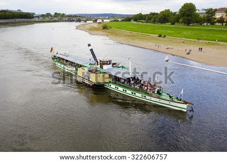 DRESDEN, GERMANY - SEPTEMBER 19, 2015: Steamer Diesbar (1884) on waters of the Elbe. It is powered by a steam engine, powered by coal which is considered to be the oldest still running in the world