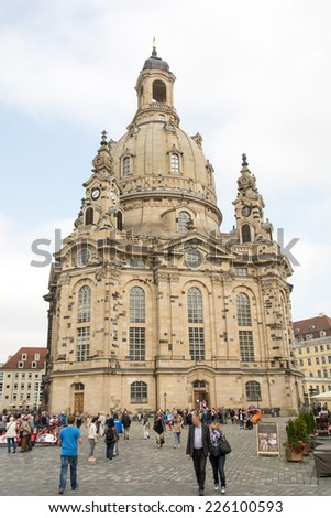 DRESDEN, GERMANY - SEPTEMBER 4: Tourists at the Frauenkirche in Dresden, Germany on September 4, 2014. The church was badly damaged during the Second World War and was restored until 2005.