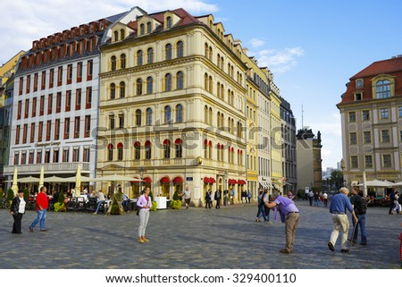 DRESDEN, GERMANY - SEPTEMBER 19, 2015: Unidentified tourists at the New Market Square, the central and culturally significant section of the inner city, it is a place often visited by many tourists - stock photo