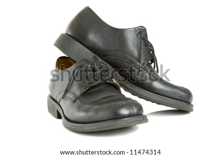 dress shoes isolated on white symbolizing the end of the work day