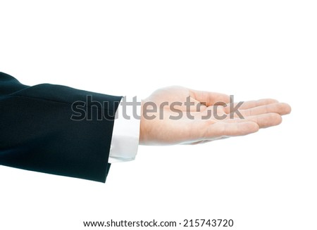 Dressed in a business suit caucasian male hand gesture of an opened palm, high-key light composition isolated over the white background - stock photo